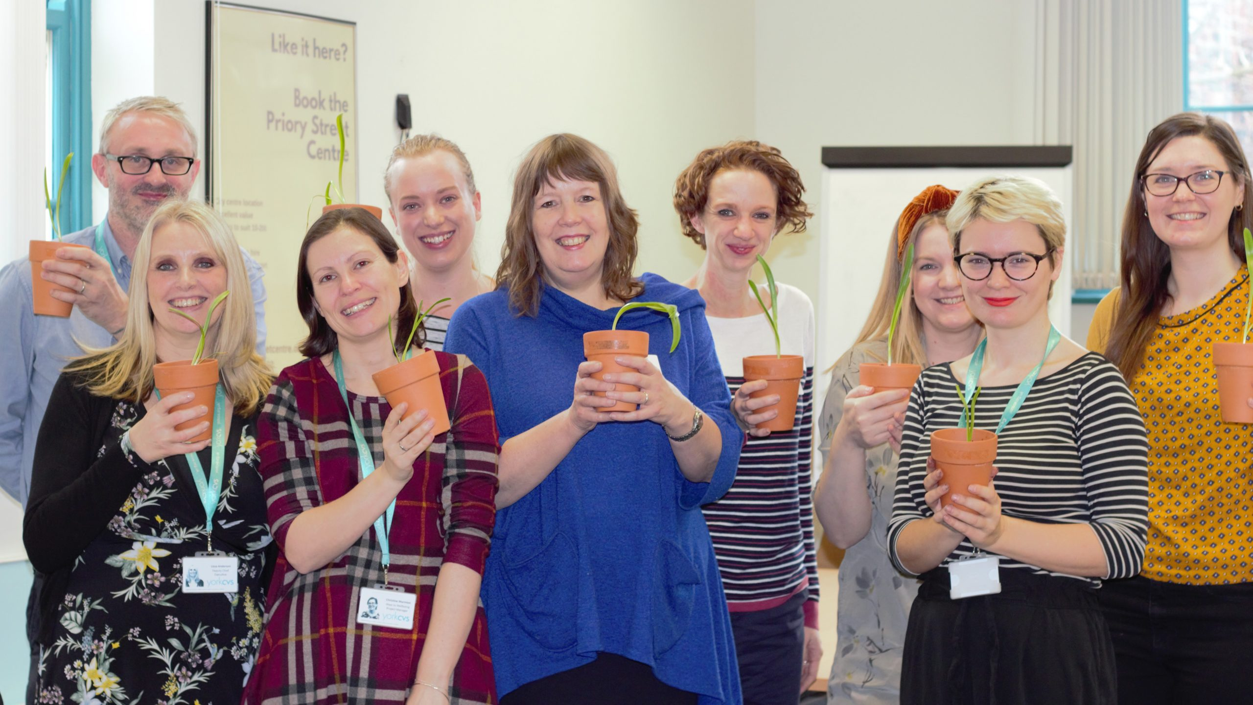 Attendees holding their potted snowdrops at the Growing Green Spaces workshop